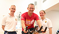 Peter Gibson with physiotherapists Mark Raven and Sophie Aitchison